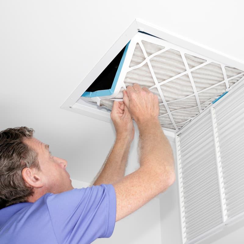 man fitting air filter