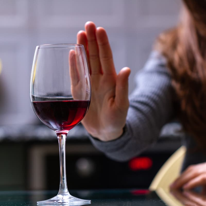 woman refuses some wine