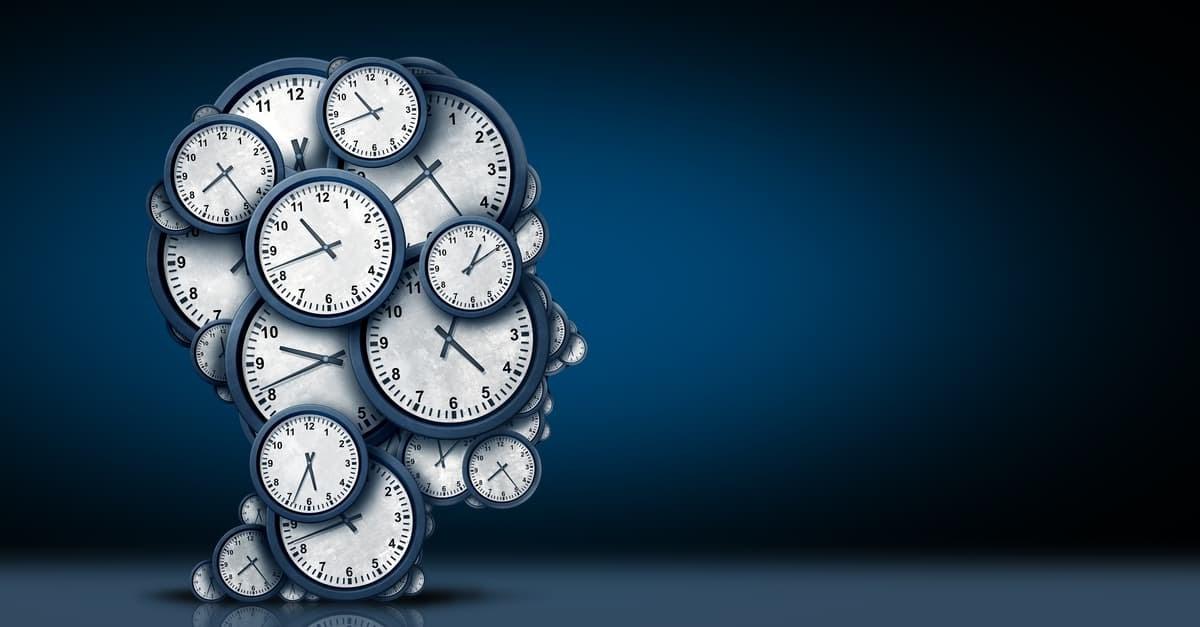 Human head covered in clocks
