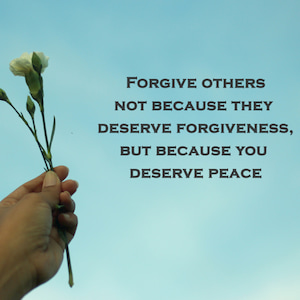 Inspirational motivational quote-Forgive others not because they deserve forgiveness, but because you deserve peace. With a young plant in hand on a blue sky background