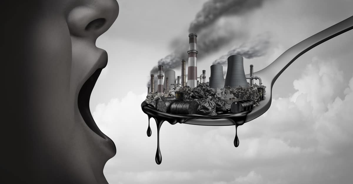 Concept of pollution and toxic pollutants inside the human body and eating contaminated food