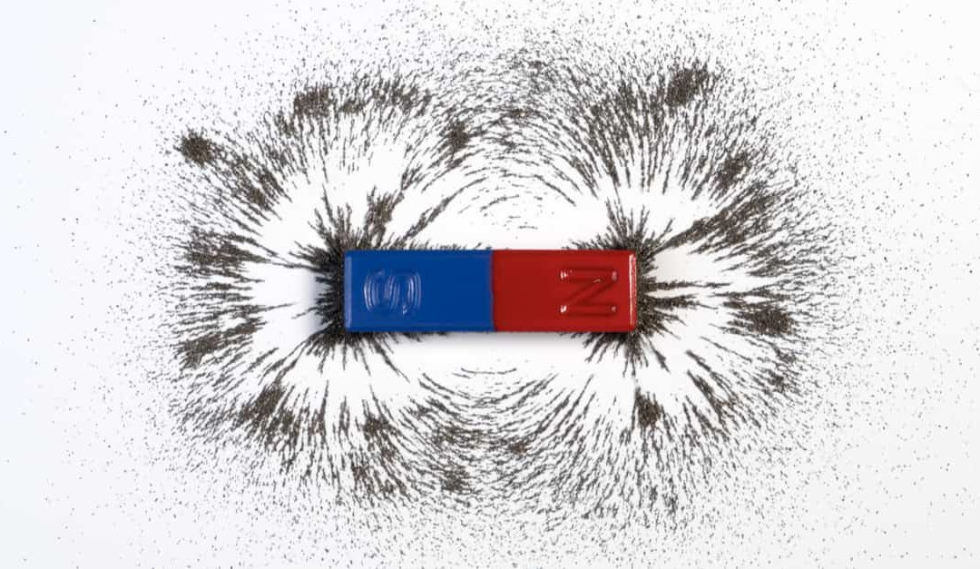 Red and blue bar magnet or physics magnetic with iron powder - magnetism effect