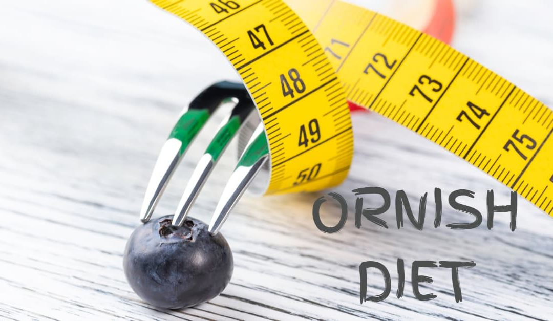 Ornish Diet concept - A dessert fork, wrapped with a yellow measuring tape, stands on a blueberry on a white wooden table