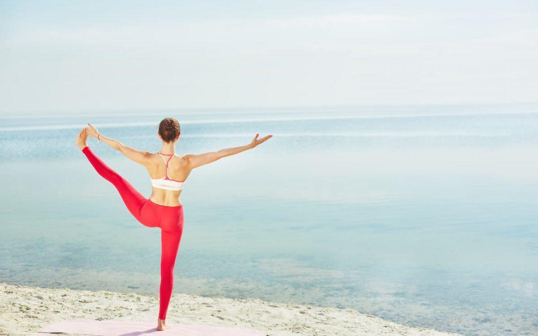 woman balancing energy on the beach